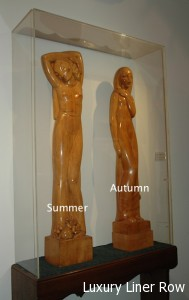 Two statues of the Four Seasons by Norman Forrest.